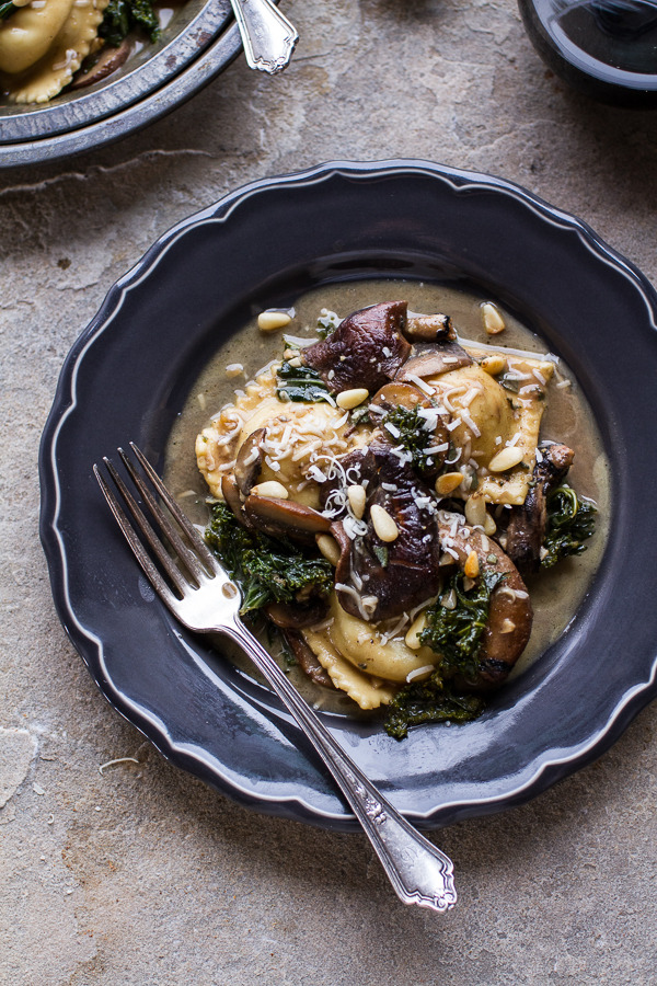 Taleggio Ravioli with Garlic-Butter Kale and Mushroom Sauce and Toasted Pine Nuts