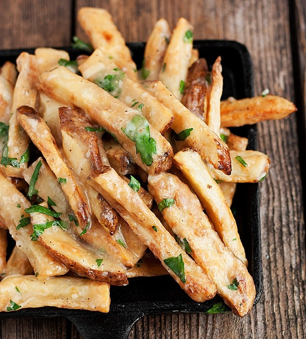 Oven-baked fries with gravy, cheddar, parmesan and fresh herbs